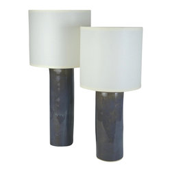 Medium Cylinder Lamp - Handmade from stoneware clay and topped with a sleek, cream linen shade, this cylinder lamp is the perfect example of incredible craftsmanship. With this charming lamp on your side table or nightstand, you'll give your room a modern look with a personal touch.