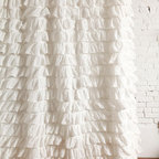 Waterfall Ruffle Shower Curtain, Ivory - This ruffled shower curtain makes everything look so lush and elegant. It's perfectly paired here with white brick walls and a beautiful claw-foot tub — it's my dream bathroom.