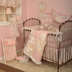 Cotton Tale Designs - Heaven Sent Girl 8 Piece Crib Bedding Set - A quality baby bedding set is essential in making your nursery warm and inviting. All Cotton Tale patterns are made using quality materials and are uniquely designed to create your perfect nursery. The Heaven Sent Girl 8 pc Collection is a beautiful combination of Pinks and Cream. This 8 pc set includes the 4pc bedding set(dust ruffle, fitted crib sheet, coverlet, and bumper), diaper stacker, toy bag, pillow pack, and valance. Touches of sheer cloud like fabrics and soft minky make this pattern irresistible. The quilt and bumper are appliqued with spiritual messages celebrating the joy of birth. Heaven Sent, A Perfect Gift from God, The Lord is my Sheppard, and I am Wonderfully Made, are the four embroidered blessings on white linen patches accompanied by sweet appliqued angels, sheep and wrapped gifts. The 4 sectional bumpers patch worked front and back. The sheet is 200 plus thread count and 100% cotton. The crib skirt is a shirred, fully lined, cream and pink floral, 16 inch drop. Diaper stacker is 21x7x9, the Toy Bag is 27x13, Valance is 17x45, and the Pillow Pack has two pillows measuring 11x9 and 12x12. The bedding is to be washed in the gentle cycle, separate, cold water. Tumble dry low or hang dry. Perfect for your little angel.