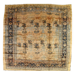 """Handmade Senneh Carpet - The pale gold field of this rare antique square Senneh from Kurdistan displays the classic Persian bird and flower bouquet (gol-i-bulbul) pattern ultimately derived from 18th century silk textiles. The dark blue main border has an amusingly naive rendition of the """"turtle"""" motif."""