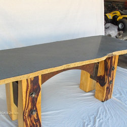 Furniture - Clear powder coated patina steel with welding done by listed artist Russ Lamb of Ketchum,Id. on the Teak Stem Tables and the massive Parota Natural edge Slab top. The Teak Stumps are mounted on heavy Bronze plagues that are patine d from light to dark as the teak is stained from natural to darker,then mounted to the opposite of the color spectrum. They are spaced off the bronze and LED back lighted in the space between the wood.   The Iron arch table is the exotic, extremely dense Tamrin wood for legs and a natural edge Massive Slate Slab!