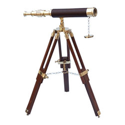 "Handcrafted Model Ships - Floor Standing Brass/Leather Harbor Master Telescope 30"" - Leather - The Hampton Nautical Brass-Leather Telescope 30"" is a true nautical gem that can serve as a functional telescope or a symbol of seafaring pride in any room or office. Focusing is accomplished by adjusting the eyepiece ring on the telescope tube, and a solid brass cap is included to protect the lens when not in use. The stand has an adjustable knob to change and hold a specific direction. This solid brass nautical gem adds a beautiful shine and warmth to any room it graces. The wooden tripod stand features smooth, polished round legs, each with solid brass fittings and a screw release to let you adjust the height. A solid brass chain holds the three wooden legs together so the telescope can maintain its position. Dimensions: 14"" L x 3"" W x 30"" H."