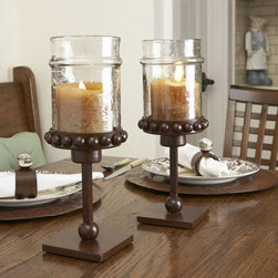 "Castilian Pillar Candle Holders - Wrought iron is hand forged and painted. 20"", 23"" & 29"". Hurricane glass is 8"" x 4""."