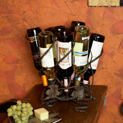 Wine Lazy Susan - 9 Bottles - This lazy susan wine rack is a perfect blend of form and function, as nine bottles rest comfortably & safely amid black wrought iron, scroll designs and a wandering grape vine.