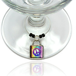 "Made on Terra - Peace Sign Flowers Rainbow Wine Glass Silver Charm - Your guests have arrived and the atmosphere is electric. A sip of wine here, a sip of a cocktail there and you find the conversation turning to the charming baubles you've placed on the glasses, something special you chose for each of your eclectic guests. They love them and appreciate your thoughtfulness. You love them for their uniqueness and that no one forgets which glass they were using.  Choose from Made on Terra's many designs for the best party ever. Ring is 1"" diameter; measures 2"" from top of ring to bottom of charm. Made of metal and plastic. Sold individually."