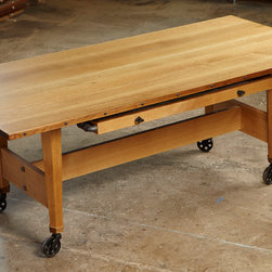 Steampunk Suite - Steampunk-inspired oak dining table. Vintage iron casters and piton pulls. Refined industrial style.