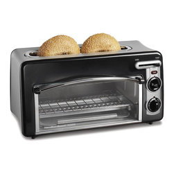 HamiltonBeach - Toastation Toaster Oven in Black - Compact 2-in-1 appliance. Top slot works as traditional 2-slice toaster. 1.5-inch wide toasting slots fits thick breads. Oven can fit two personal pizzas. Electronic toast shade and oven temperature controls provide for consistency. Removable crumb tray and automatic toaster shutoff for convenience. Total wattage: 1300 W. Warranty: One year limitedThe Toastation Toaster Oven in Black is sleek yet practical, for a contemporary kitchen. Popular not only for its expert toasting performance, it also looks great in the kitchen. A compact, 2-in-1 appliance intended to prepare foods most commonly cooked in a toaster oven, such as appetizers, pizza, bagels, chicken nuggets, fries and toaster pastries. The slide-out crumb tray makes cleanup a snap.