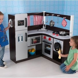 KidKraft Grand Espresso Corner Play Kitchen - Talk about multi-tasking! The KidKraft Grand Espresso Corner Play Kitchen is equipped with everything little moms and dads need to keep their household in proper working order. They can whip up a tasty dinner on the two-burner stove and keep foods properly chilled in the fridge/freezer combo. The microwave will be handy when it's time to heat up a quick snack and the oven is a must for the little baking enthusiasts. And when they're all done with their cooking the washing machine will be perfect for cleaning their aprons. The kitchen sink is removable so the real mom and dad can easily clean it. Kids will love the realistic details like clicking knobs and real fabric curtains. There's even a four-piece metal accessory set. A chalkboard on the freezer door helps them keep track of their important appointments and the wall-mounted phone means a phone call to Grandma is just a moment away. This play kitchen is recommended for children age 3-6 years. Assembly is required but detailed step-by-step instructions are included. Dimensions: 36L x 36W x 35.5H inches. About KidKraftKidKraft is a leading creator manufacturer and distributor of children's furniture toy gift and room accessory items. KidKraft's headquarters in Dallas Texas serves as the nerve center for the company's design operations and distribution networks. With the company mission emphasizing quality design dependability and competitive pricing KidKraft has consistently experienced double-digit growth. It's a name parents can trust for high-quality safe innovative children's toys and furniture.