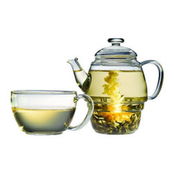 Teaposy - Teaposy Charme Gift Set - Give yourself or a friend the gift of a quiet moment in one elegant package. This lovely 16-ounce handblown glass teapot sits on a glass teacup sized for one and includes three blossoming silver needle teas as well as two loose-leaf teas. Let your thoughts melt away as you watch the tea leaves or blossoms unfold before your eyes; then serenely sip your tea for the second act.