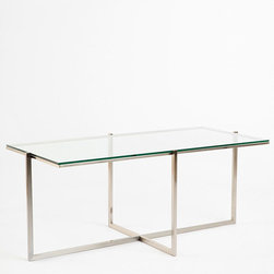 Crisscross Table - I have a glass-topped coffee table in the living room, and I love that it doesn't take up as much space visually as a solid table would. This one has a modern classic design that would easily fit into a range of interior styles.