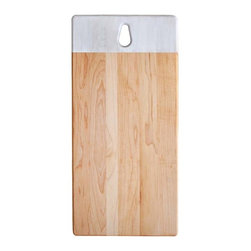1.4 Cutting Board - Simple and slender, the cutting board 1.4 is made of maple or yellow birch and is bordered by a strip of white milk paint. The hole at the top allows you to hang the board on the wall.