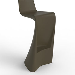 Frontgate - Wing Outdoor Bar Stool - Crafted of rotationally molded, low density linear polyethylene. Impact-resistant. Suitable for indoor and outdoor use. The Wing Dining Collection is a result of folding curved and straight lines to create furniture that truly can be called art. Each piece features straight lines and calculating curves that artistically mimic the aerodynamics of flight. Slender enough for small spaces, these sculptural pieces will enhance the ambiance of any modern area. Contemporary and brazen, this set is perfect for creating a futuristic yet sensual atmosphere both inside and out.  .  .  .