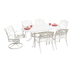 "Home Styles - Home Styles Biscayne 7PC 72"" Oval Dining Table Set - Home Styles - Dining Sets - 55523358C - Biscayne 7PC Dining Set includes the Oval Table Four Arm Chairs with Sunbrella Green Apple fabric Cushions and Two Swivel Arm Chairs with Sunbrella Green Apple fabric Cushions- Home Styles cast aluminum outdoor dining collection gives you the beauty of ornately designed pieces without the high cost. Constructed of cast aluminum in a UV resistant powder coated White finish. The Oval Dining Table features a top that is designed specifically to prevent damage caused from pooling by allowing water to pass through freely. Adjustable nylon glides prevent damage to surfaces caused by movement and provide stability on uneven surfaces. Size: 42w 72d 30h. Home Styles Arm Chair is constructed of cast aluminum with a White Finish. Features include powder coat finish sealed with a clear coat to protect finish and nylon glides on all legs. Chairs are packed two per carton. Item Size: 22.83w 21.65d 32.68h (Seat height 15.5H) Home Styles Swivel Arm Chair is constructed of cast aluminum with a White Finish. Features include powder coat finish sealed with a clear coat to protect finish and nylon glides on all legs. Item Size: 24.4w 22d 33.46h (Seat height 16 inches high). Stainless steel hardware."