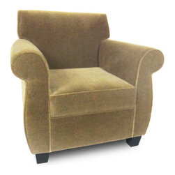 "Passport Home - Arnie Chair - Full of character, the Arnie chair redefines the classic roll-arm silhouette. Its allure lies in the soft shape of the design originating at the roll of the arm and curving down to the leg. Arnie's signature style complements all types of interiors, and its comfortable seating makes everyone feel at home. The Arnie chair is upholstered in a high quality fabric with the look of mohair. Features: -Solid wood legs.-Seat cushions of high performance.-Attached arm and back pillows.-Seams are sewn with bonded nylon.-Monofilament threads for strength and flexibility.-Soft and resilient 1.8 high density polyurethane foam with foam wrap.-Frame meets the strict standards of the California Air Resources Board.-Major frame joints are corner blocked, glued, and stapled for added stability.-Outside panels are padded to add softness and support to the fabric or leather, preventing it from sagging and becoming loose.-Tempered steel sinuous springs for both back and seat suspension ensures that your back pillows and seat cushions are properly supported and that extraordinary seat comfort is provided.-Made in the USA.-22.5"" H x 33"" W x 31"" D, 60 lbs.-Collection: Arnie.-Upholstered: Yes .-Distressed: No.-Country of Manufacture: United States.Dimensions: -Overall Product Weight: 60 lbs."