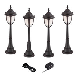 """Super Duty - Traditional Super Duty Casa Sorrento Bronze 6-Piece LED Landscape Set - Offer access lighting to your outdoor spaces with this complete landscape lighting set from the Casa Sorrento Super Duty™ line. Four low voltage and energy efficient LED landscape lights with marbleized glass and a bronze finish provide illumination. A 45-watt low voltage transformer is included for free which features a built-in photocell for dusk to dawn operation. A black landscape wire completes the kit so you can connect your lights bringing this set together for a spectacular look. Works with existing low voltage landscape lighting systems.  Design by the Super Duty™ line.  6-piece set in bronze.  Cast aluminum construction.  4 LED landscape lights one 45-watt low voltage transformer cable.  Path lights include integrated 3 watt LED module.  Comparable to a 25 watt incandescent bulb.  Free 45 watt transformer.  Full ON mode or 3 AUTO settings (4 6 and 8 hours).  Built in photo-cell for dusk to dawn operation.  Free 50 feet of cable.  Includes 9 1/2"""" ground stakes.  Lights are 30 1/2"""" high 7 1/2"""" wide."""