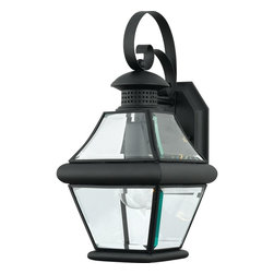 Quoizel - Quoizel 1 Light Rutledge Outdoor Wall Lanterns, Mystic Black - RJ8407K - This outdoor lantern expresses simplicity of design. Clear beveled glass gives an unobstructed path of light to brighten your outdoor landscape. The three finishes available in this collection are mystic black, pewter and Medici bronze. with these timeless finishes to choose from, your outdoor lighting will tie in flawlessly to your home.