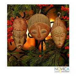 Novica - Set of 3 Sese Wood 'Three Kings' Ornaments (Ghana) - West Africa's Daniel Nyadedzor hand-carves this set of three tree ornaments. Working with sese wood,the ornamental masks depict the three kings who proffered gifts to Baby Jesus.