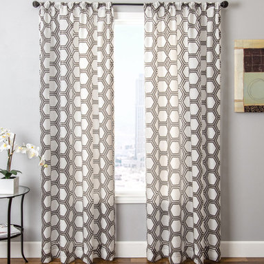 Blindsgalore Signature Drapery Panel: Renegade Sheer - This beautiful sheer burnout drapery panel features a geometric pattern in décor-friendly colors. The sheer fabric gently filters light and provides a beautiful accent to the room. Pair these with an undertreatment like a wood blind for the perfectly dressed window. Blindsgalore's Signature drapery panels make your home beautiful with designer fabrics that don't have the designer price.