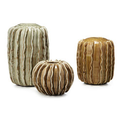 Modern Ceramic Vases - Set Of 3 - Lend a Southwestern feel to your home and celebrate the simple beauty of the desert with this trio of vases. Cast in ceramic clay, each design is highlighted by a warmly weathered finish and rustic glaze. The cacti silhouette lends natural appeal, while the ample interiors are perfect for your favorite potted plant, cattails, or colorful skeins of yarn.
