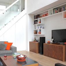 Contemporary Family Room by Alguacil & Perkoff Ltd.