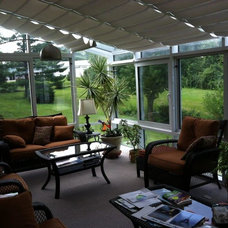 Tropical Porch by Patio Enclosures by Great Day Improvements, LLC