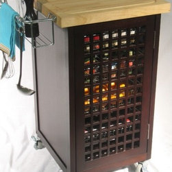 "Chris & Chris - Chef Pantry Kitchen Cart - Features: -The ultimate self contained state of the art food preparation center on wheels.-Easy disposal of waste and effortless clean up.-Juice groove on the cutting surface, to collect juices and direct their flow to the ''Pig Snout'' (a cut out in the work surface).-Stainless steel chef pan fits snuggly below the ''Pig Snout'' to collect the juices or cut product.-Designed to replace the chef pan when it is desirable to dispose of waste directly into a trash bag.-Trash ring is designed to accept either a common plastic grocery bag, or various size kitchen trash bags.-It has 4 removable wire basket drawers and oversized towel bar with 4 ''S'' hooks.-Speed rack for holding ingredients.-4 commercial grade casters (2 locking).-2 Lattice cabinet doors.-Access drawers from both sides.-Magnetic door latches.-Includes trash ring and trash bag feature.-Wood top finish: Natural engrain oil.-''Chop and Drop'' system which allows for the sanitary collection of juices and prepared foods.-Product Type: Food Prep Island.-Collection: Chris & Chris.-Counter Finish: Natural engrain oil.-Hardware Finish: Nickel.-Distressed: No.-Powder Coated Finish: Yes.-Gloss Finish: No.-Base Material: Wood.-Counter Material: Rubberwood.-Hardware Material: Steel.-Solid Wood Construction: Yes.-Stain Resistant: No.-Warp Resistant: Yes.-Exterior Shelves: Yes.-Drawers Included: Yes -Number of Drawers: 4.-Push Through Drawer: Yes.-Dovetail Joints: No.-Drawer Dividers: No.-Silverware Tray : No..-Cabinets Included: Yes -Number of Cabinets : 1.-Double Sided Cabinet: Yes.-Number of Interior Shelves: 4.-Adjustable Interior Shelves: Yes.-Number of Doors: 2.-Magnetic Door Catches: Yes.-Locking Doors: No..-Number of Baskets: 4.-Towel Rack: Yes -Removable Towel Rack: Yes..-Pot Rack: Yes -Removable Pot Rack: Yes..-Spice Rack: Yes -Removable Spice Rack: Yes..-Cutting Board: Yes.-Drop Leaf: No.-Drain Groove: Yes.-Trash Bin Compartment: Yes.-Stools Included: No.-Casters: Yes -Locking Casters: Yes.-Removable Casters: Yes..-Wine Rack: No.-Stemware Rack: No.-Cart Handles: No.-Finished Back: Yes.-Weight Capacity: 100 lbs.-Shelf Weight Capacity: 25 lbs.-Swatch Available: No.-Commercial Use: No.-Recycled Content: No.-Eco-Friendly: No.Specifications: -ISTA 3A Certified: Yes.Dimensions: -1.5"" thick end grain chopping block surface.-0.75"" thick lattice doors.-Overall Height - Top to Bottom: 36"".-Overall Width - Side to Side: 26.65"".-Overall Depth - Front to Back: 20"".-Width Without Side Attachments: 20"".-Countertop Thickness: 1.25"".-Countertop Width - Side to Side: 20"".-Countertop Depth - Front to Back: 20"".-Shelving: -Shelf Height - Top to Bottom: 6"".-Shelf Width - Side to Side: 16.38"".-Shelf Depth - Front to Back: 16""..-Drawer: -Drawer Interior Height - Top to Bottom: 5"".-Drawer Interior Width - Side to Side: 16.38"".-Drawer Interior Depth - Front to Back (Top Drawer) : 9.32"".-Drawer Interior Depth - Front to Back (Bottom Three Drawers) : 16""..-Cabinet: -Cabinet Interior Height - Top to Bottom: 29.63"".-Cabinet Interior Width - Side to Side: 16.38"".-Cabinet Interior Depth - Front to Back: 16.5""..-Overall Product Weight: 78 lbs.Assembly: -Assembly Required: Yes.-Additional Part"