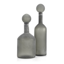 Vesuvius Bottles - Grey - Z Gallerie's exclusive Vesuvius bottles, with the appearance of glass discovered on a long-lost shipwreck, bring a distinctive decorative element to a room. The bottles are crafted of heavy Grey glass, with a removable large spherical stopper, and are finished in frosty White to give them the look of weathered glass. Available in two sizes, 7 inches diameter by 16 inches tall and 5 inches diameter by 21 inches tall, they are intended for decorative use only. Combine with our Aubergine, Teal or White Vesuvius bottles for a more impressive display.