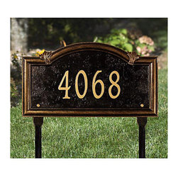 Ballard Designs - Somerset Arch One Line Lawn Address Sign - Antique gold lettering. Contrasting black background for high visibility. Acanthus scroll details. Two lawn stakes. Our Somerset Arch lawn address sign has a classic look that will turn your address into the nicest one on the block. It's crafted of sand cast aluminum with weather-resistant paint to last the life of your home. For One-Line: Up to 5 numbers/spaces; for Two-Line: Up to 5 numbers/spaces for top line and up to 16 characters/spaces for bottom line. Somerset Arch Lawn Sign features:  . . . . *Please note that personalized items are non-returnable.