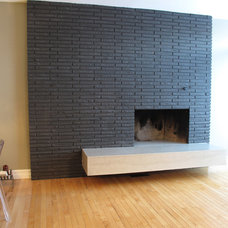 Modern Indoor Fireplaces by Concrete Cat Inc.