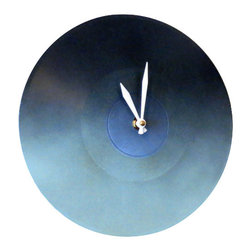 """Modern Ombre Wall Clock - Add a pop of color to your decor with this 10"""" handpainted  blue ombre  record wall clock. The most utilized accessory in any room is the clock. We all glance at the clock, whether to avoid  being late for work or to make sure that batch of cookies in the oven does not burn. Since it is the most used accessory, it should be stunning, right? This blue ombre wall clock has been upcycled from a 10"""" record record.  It keeps the time perfectly and will give your room a much need dose of style."""