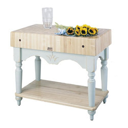 John Boos - Wood Table w Maple End Grain Top (Alabaster) - Color: AlabasterIncludes solid maple lower shelf. 4 in. Square solid maple turned legs. 7 in. Thick end grain hard maple top. Pictured in Alabaster