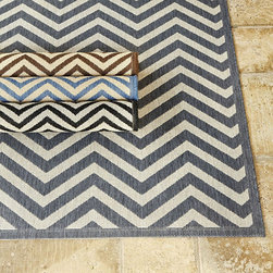 Ballard Designs - Chevron Stripe Indoor/Outdoor Rug - Perfect for the kitchen or family room. Great for warming up covered outdoor spaces. Sizes are approximate. Imported from Belgium. Chevron stripes are everywhere we look, from the runway to the showroom. Machine loomed in a soft sisal weave of durable, non-fading, washable 100% mildew resistant polypropylene. To clean, just wash with mild soap or rinse with a hose. Use of a Rug Pad, is recommended. Chevron Stripe Rug features: . . . .