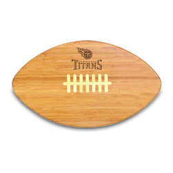"""Picnic Time - Tennessee Titans Touchdown Pro Cutting Board in Natural Wood - The Touchdown! cutting board is a 15"""" x 8.75"""" x 0.75"""" board made of eco-friendly bamboo with a standard football design, with 123 square inches of cutting surface. It can be used as a cutting board or serving tray, or use both sides of the board, one for cutting and the other for serving. The backside of the board is solid dark bamboo. Go long...for the Touchdown! Decoration: Engraved"""