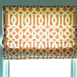 Roman Shades - Roman Shade in orange geometric patterned fabric.