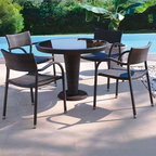 Papaya Collection Outdoor Wicker Dining Table and Chairs - The Papaya Collection features a round outdoor wicker dining table with a glass top and matching dining chairs.