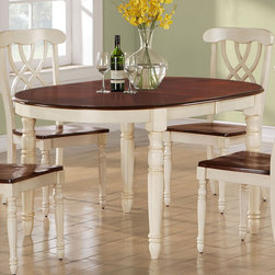 Monarch - Antique White / Walnut Veneer 42in.x60in.x78in. Dining Table - Finished in a walnut veneer, this traditional dining table will create the perfect look for intimate dinners or casual get togethers. The rectangular shaped piece features curved edges, turn post legs, and is brushed in an antique white color. This table has a simple yet stylish look that can blend into any decor.