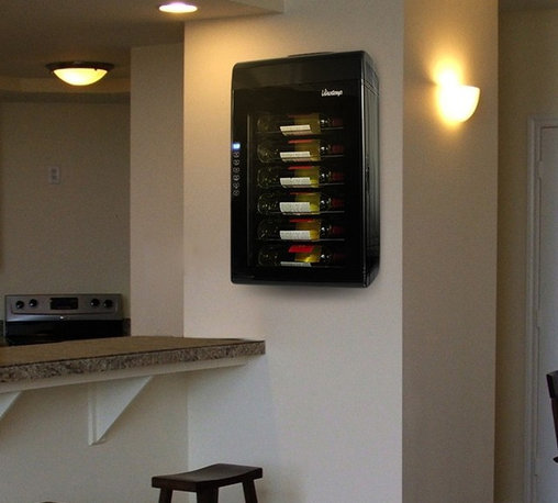 Vinotemp - Thermoelectric Wine Cooler - Sleek and wall-mount design. Black touch screen. Capacity: 6 bottles. 16.75 in. W x 7.75 in. D x 30.25 in. H (28 lbs.). Assembly required. 3-5 days lead time. Eco-friendly thermoelectric technology. Easy-to-use touch screen temperature control and digital temperature display. Interior lighting to gently illuminate bottles. Glass door with recessed handle. Temperature range: 45塉��68�F. WarrantyThe compact design of the Thermoelectric Wine Cooler is wonderful for those who are beginning their wine collection and it serves as a fun show piece in your kitchen.