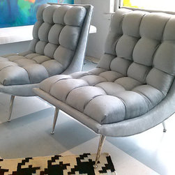 Pair of Hollywood Regency Slipper Chairs by Florida Modern 33405 - These Hollywood Regency–style chairs come in a neutral blue/gray silk fabric and rest on chrome legs. They are the right way to rock retro!