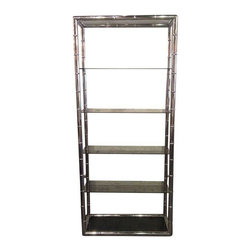 Pre-owned Chrome Faux Bamboo Etagere - This etagere can add a touch of glam and look amazing in any room. It's small enough to make a statement and not overpower a space. The shelf has a chrome body with 6 pieces of opaque colored glass.