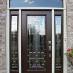 Arched Brick Doorway with Decorative Glass Door - A decorative wooden entry door with came glasswork in an arched brick doorway installed by Opal Enterprises in Lisle, IL