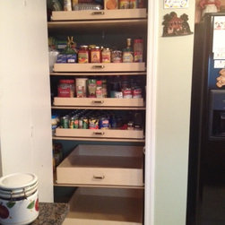 Pantry Pull Out Shelves - Custom pull out pantry shelve from ShelfGenie of Miami.  These shelves have handles installed for easy tugging without disturbing the contents of the pantry.