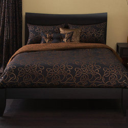 Michael Payne - Twisty Vine Duvet Set in Copper - -Twin Duvet Set Includes: -Duvet. -Duvet insert. -Pillow Sham. -Two decorative pillows. . -California King, King, Queen and Full Duvet Set Includes: -Duvet. -Duvet insert. -Two pillow shams. -Two decorative pillow. . Features: -Six Piece Duvet Set. -Twisty vine collection. -Copper finish. -Duvet Set Available in: -Twin size. -Full size. -Queen size. -King size. -California king size. . -Made of 60% polyster, 20% Nylon, 20% Metalic yarn material. -Dry Clean Only.