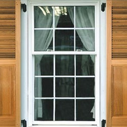 Cedar Louvered-Panel Exterior Shutters - Exterior cedar shutters bring a sense of warm personality to any home, and the Cedar Combination Louvered-Panel Exterior Shutter available via Hooks and Lattice is no exception. These wood window shutters are a merging of the raised panel and louvered window shutter style: two historically beloved designs. Each duo of cedar exterior shutters will allure with their smart and eclectic character.