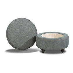 Klaussner - Contemporary Storage Ottoman - Jazz pattern in teal. Round and compact. Lift top. Clean lines on bordered and welted pillow top. Tapered and circular wood legs. Made in USA. 28 in. Dia. x 21 in. H (34 lbs. ). Are you needing the perfect accent piece to add to your home. The Orion ottoman is just that. Place the ottoman in any room for extra seating, a place to rest your tired legs or as a functional cocktail table. The Orion ottoman also hides the fact that it has storage when you lift the top off. It is the ideal hiding spot for magazines, blankets, or DVDs.