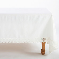 "Coyuchi - Coyuchi Grand Lace Tablecloth - The simple design of the Coyuchi Grand tablecloth expresses a soothing, rustic sentiment on a table. On soft white cotton, romantic lace trim exudes sumptuous style. 70""W x 108""H; 100% organic cotton; Due to handmade quality, slight variations in fabric may occur; Machine washable"