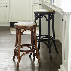 Ballard Designs - Yorkshire Barstool - Gentle curves make our Yorkshire Counter Stool look inviting from every angle. The sturdy bentwood frame is crafted of solid birch with stretchers for extra strength and a heel rest that goes all the way around. Comfortably padded seat is covered in natural rattan. Yorkshire Counter Stool features: Rattan Padded Seat. Backless design slips neatly beneath counter.
