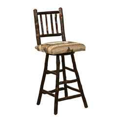 Chelsea Home Furniture - Chelsea Home Delilah 30 Inch Barstool with Memory Swivel - Esquire Standard - This richly stained hardwood Delilah Barstool in Michael's Cherry with Westville Memory Swivel is upholstered with frontier inspired fabric and is handmade with a spindle back. You or your guests can rest your feet on one of the four sturdy foot rails along the legs of the stool. Buy one or multiple stools to go along with our Pub Table! Chelsea Home Furniture proudly offers handcrafted American made heirloom quality furniture, custom made for you. What makes heirloom quality furniture? It's knowing how to turn a house into a home. It's clean lines, ingenuity and impeccable construction derived from solid woods, not veneers or printed finishes over composites or wood products _ the best nature has to offer. It's creating memories. It's ensuring the furniture you buy today will still be the same 100 years from now! Every piece of furniture in our collection is built by expert furniture artisans with a standard of superiority that is unmatched by mass-produced composite materials imported from Asia or produced domestically. This rare standard is evident through our use of the finest materials available, such as locally grown hardwoods of many varieties, and pine, which make our products durable and long lasting. Many pieces are signed by the craftsman that produces them, as these artisans are proud of the work they do! These American made pieces are built with mastery, using mortise-and-tenon joints that have been used by woodworkers for thousands of years. In addition, our craftsmen use tongue-in-groove construction, and screws instead of nails during assembly and dovetailing _both painstaking techniques that are hard to come by in today's marketplace. And with a wide array of stains available, you can create an original piece of furniture that not only matches your living space, but your personality. So adorn your home with a piece of furniture that will be future 