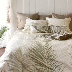Paradise Duvet Set - Palm fronds flutter across our duvet set in colors of ivory, white, pebble and sand, inviting you to sink into laid-back luxury. The trendy, tonal engineered print on 300 thread count cotton sateen creates one continuous leaf across two shams. Duvet and shams are finished in self-fabric micro-flange, and reverse to solid pebble.