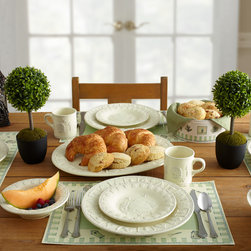 White Dinnerware - Naturewood Embossed captivates with a charming beehive motif surrounded by a unique geometric and line patterned rim. The organic look and feel has an intentional aged appearance that adds an element of rustic antiquity to your tabletop presentation.