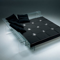 Glass Bed - Imagine sleeping in a glass bed. Rather cool, I think. I have to admit that this isn't for everyone, and it comes with a hefty price tag too. But just imagine walking into someone's loft and seeing this in the bedroom. Obviously, the sheets and pillows have to be just as chic in order to complement the extreme design of this very clever sleeping concept.